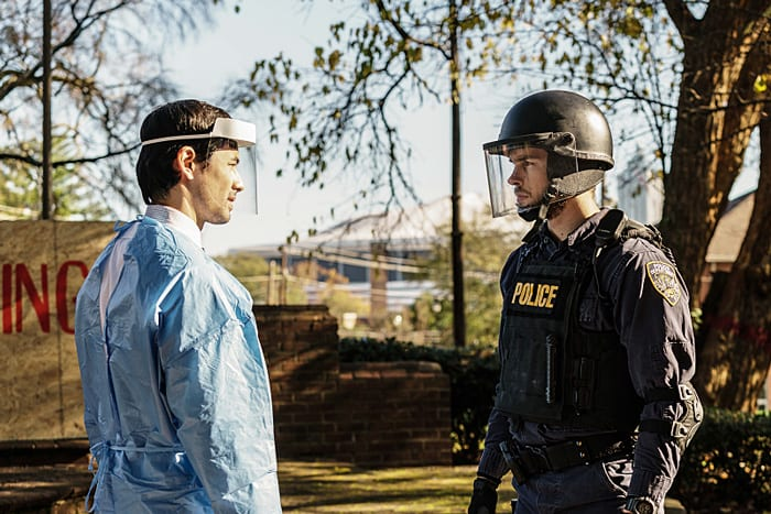 "Containment -- ""Path to Paradise"" -- Image Number: CON113a_0072.jpg -- Pictured (L-R): George Young as Doctor Victor Cannerts and Chris Wood as Jake -- Photo: Tina Rowden/The CW -- © 2016 The CW Network, LLC. All rights reserved."