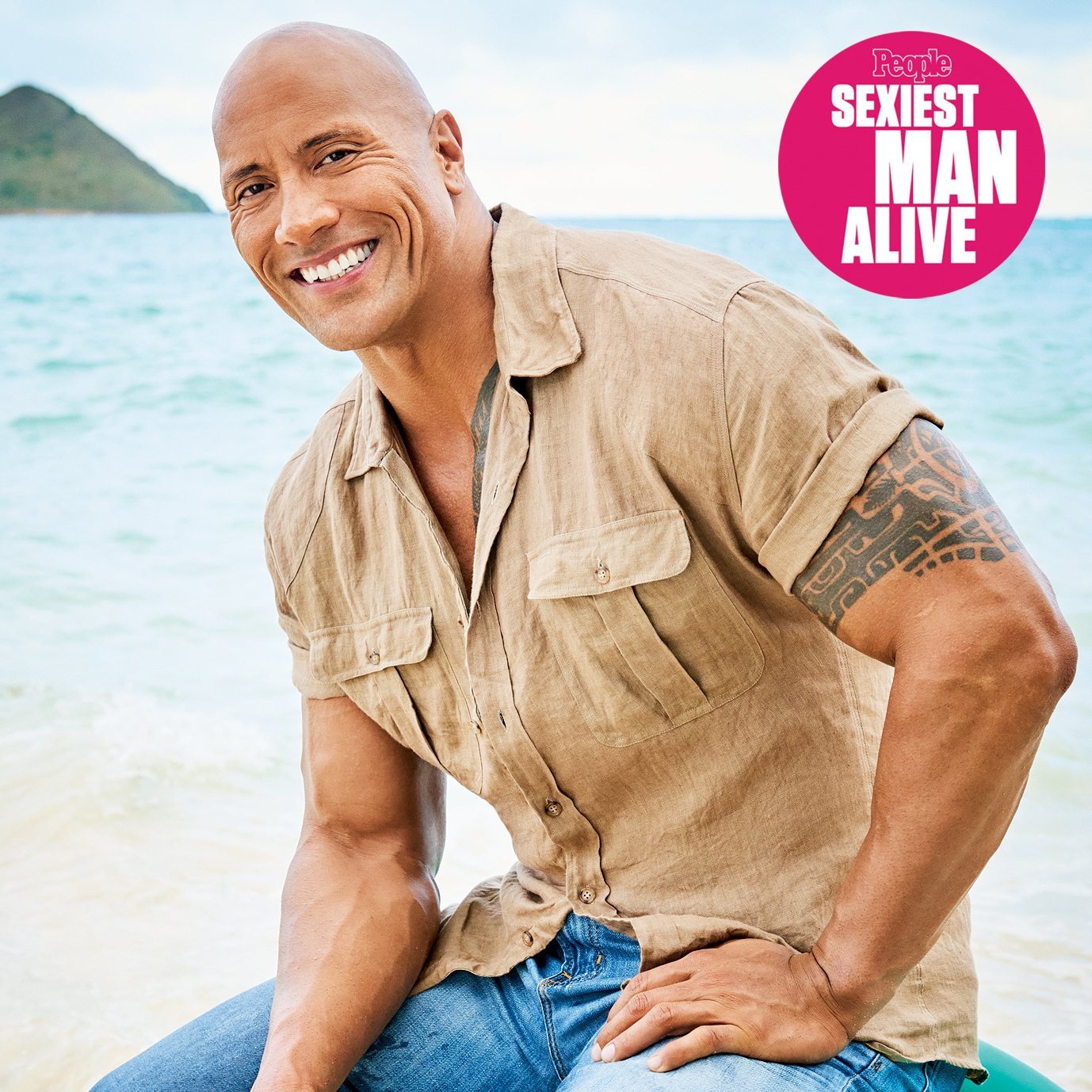 Sexiest Man Alive 2016 Dwayne Johnson The Rock photographed in Kailua, Hawaii on September 13, 2016 Photographer: Jeff Lipsky Barber: Rachel Solow Makeup: Merc Arceneaux/Merc Beauty Inc. Prop Stylist: Chris Reiner Stylist: Robert Mata Shirt: John Varvatos† Jeans: AG Jeans†