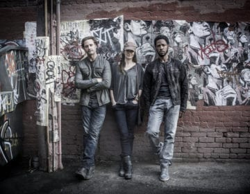 """COLONY -- """"The Garden of Beasts"""" Episode 210 -- Pictured: (l-r) Josh Holloway as Will Bowman, Sarah Wayne Callies as Katie Bowman, Tory Kittles as Broussard -- (Photo by: Isabella Vosmikova/USA Network)"""