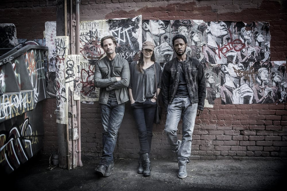 "COLONY -- ""The Garden of Beasts"" Episode 210 -- Pictured: (l-r) Josh Holloway as Will Bowman, Sarah Wayne Callies as Katie Bowman, Tory Kittles as Broussard -- (Photo by: Isabella Vosmikova/USA Network)"